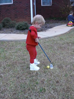 Elizabeth playing golf.